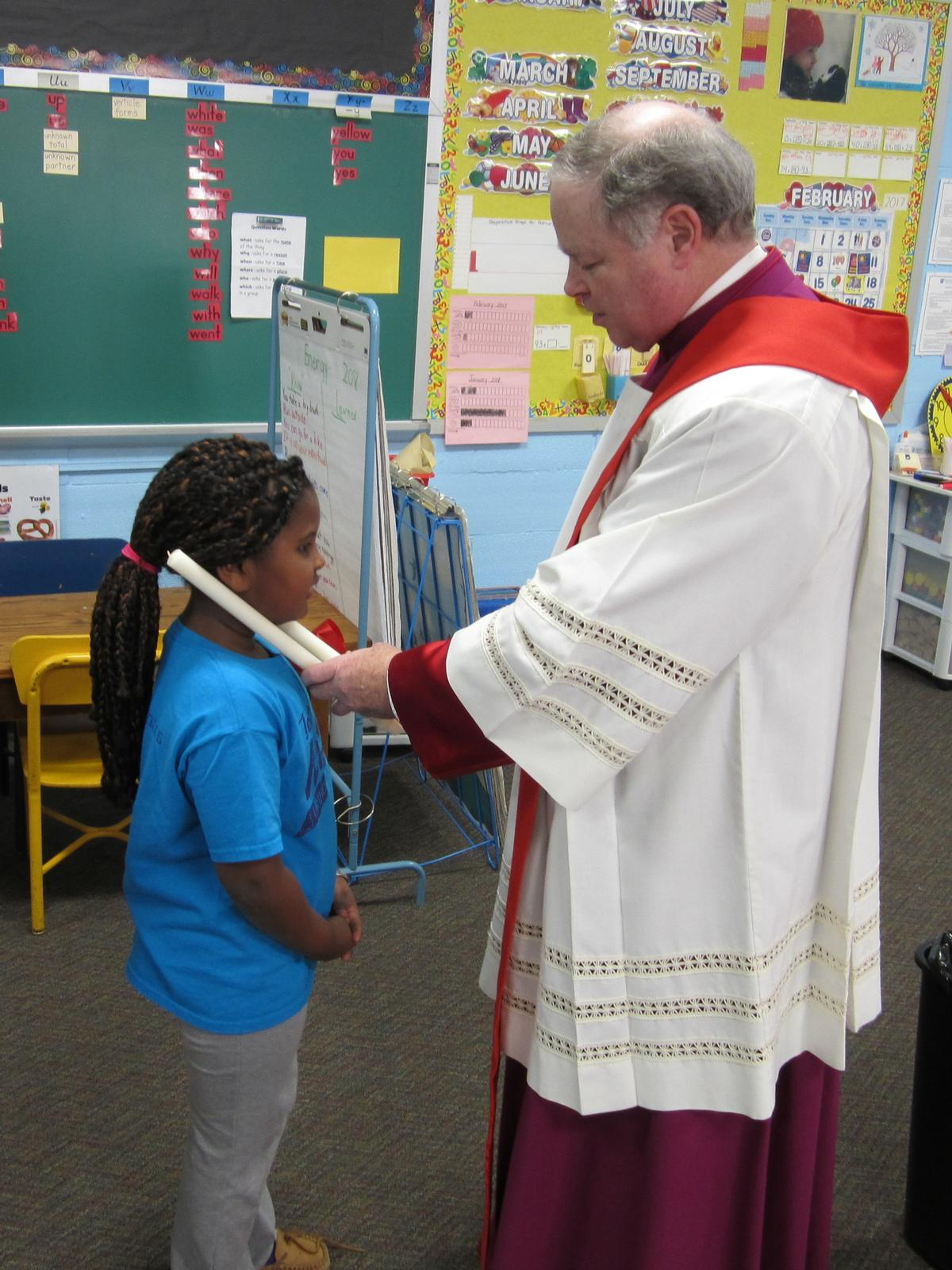 Blessing of St. Blaise for ailments of the throat.